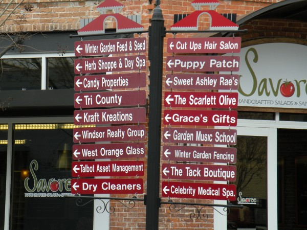 Sign with eating, drinking and sevice establishments in downtown old Winter Garden Florida